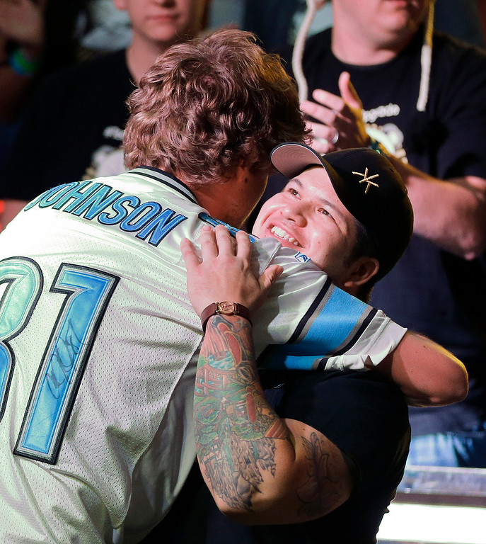 . Jay Farber gets a hug from Ryan Riess after Riess won the World Series of Poker Final Table and an $8.4 million payout, Tuesday, Nov. 5, 2013, in Las Vegas. (AP Photo/Julie Jacobson)