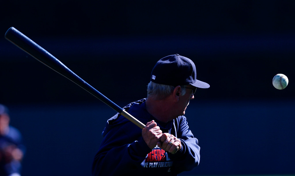 . Detroit Tigers manager Jim Leyland hits grounders during batting practice for Game 4 of an American League baseball division series against the Oakland Athletics in Detroit, Tuesday, Oct. 8, 2013. (AP Photo/Paul Sancya)