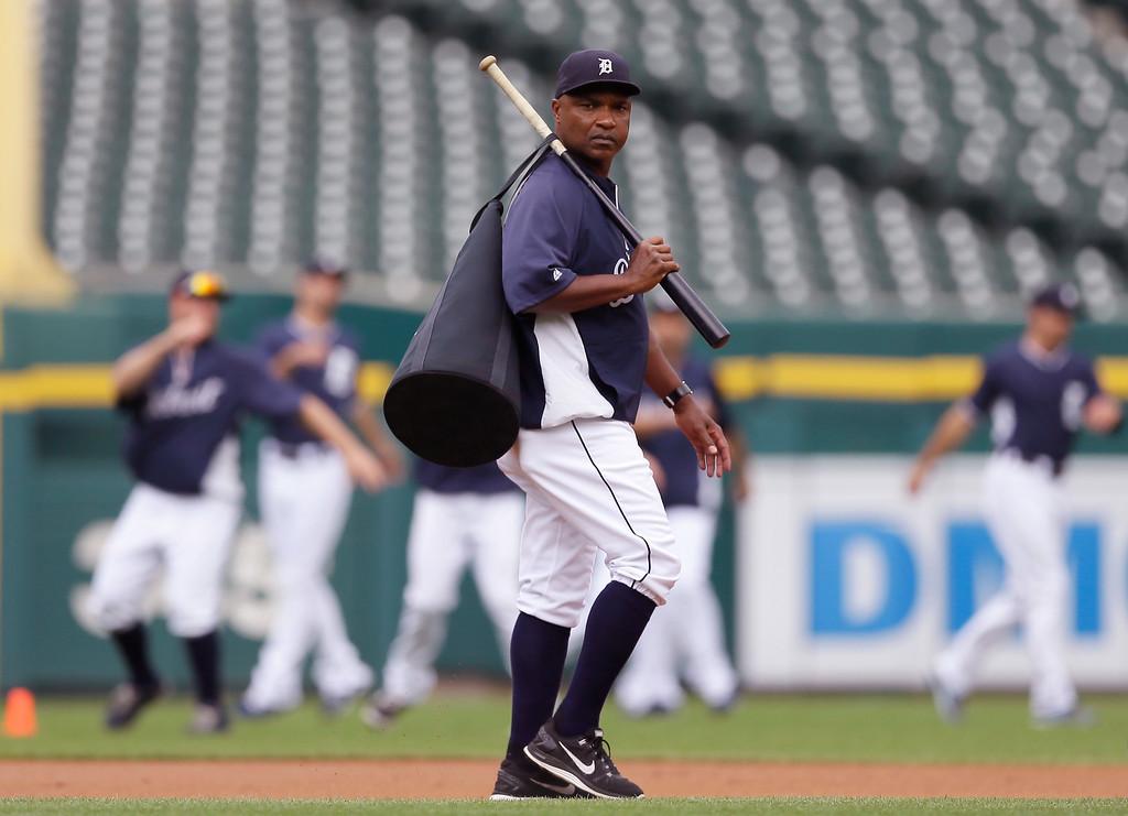 . Detroit Tigers third base coach Dave Clark is seen before an interleague baseball game, Friday, Aug. 1, 2014, in Detroit. (AP Photo/Carlos Osorio)