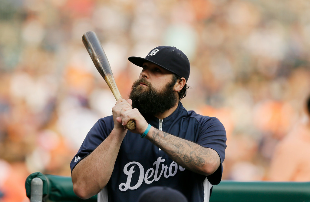 . Detroit Tigers relief pitcher Joba Chamberlain is seen outside the dugout before the first inning of an interleague baseball game against the Colorado Rockies, Friday, Aug. 1, 2014, in Detroit. (AP Photo/Carlos Osorio)