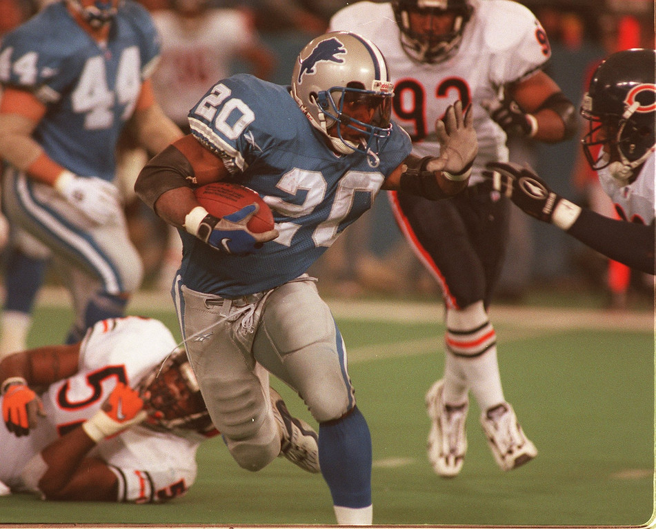 . Lions running back Barry Sanders, stiffarms his way to a 25 yard Touchdown run in the 3rd quarter angainst the Bears. The Lions beat the Bears 55-20, and Sanders became the 2nd leading rusher on this carry.