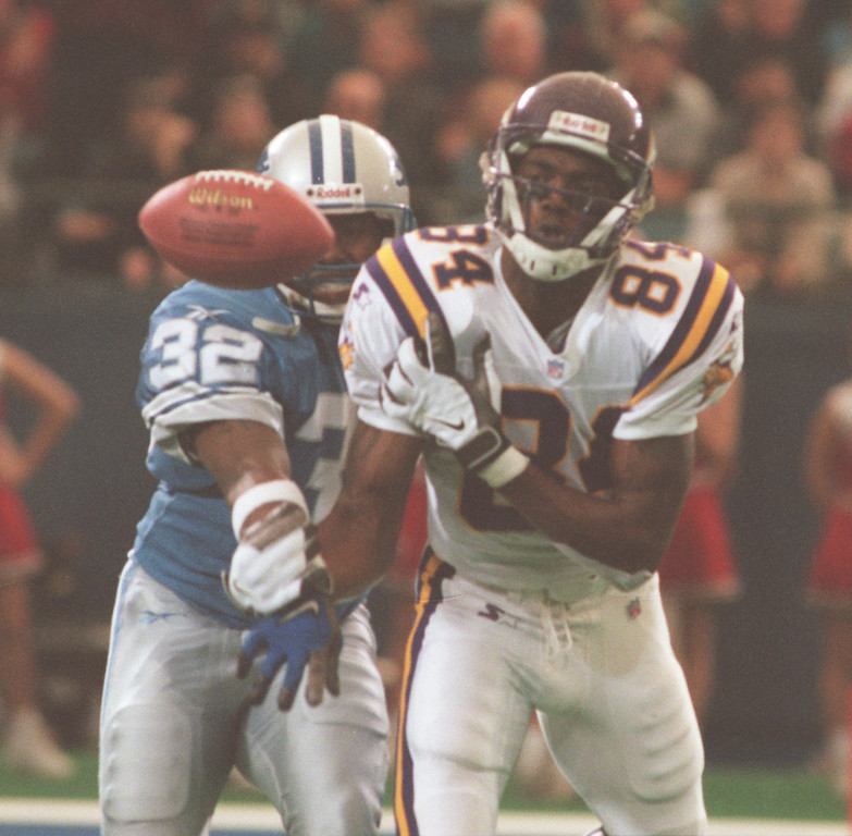 . Detroit Lions CB Bryant Westbrook breaks up a pass to Minnesota Vikings WR Randy Moss. Moss had 2 catches for 14 yards.  The Vikings beat the Lions 34-13.