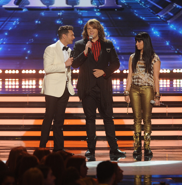 . AMERICAN IDOL XIII: L-R: Ryan Seacrest, Caleb Johnson and Jena Irene on AMERICAN IDOL XIII at the NOKIA THEATRE L.A. LIVE airing Tuesday, May 20 (8:00-9:00 PM ET / PT) on FOX.  CR: Michael Becker / FOX. Copyright 2014 / FOX Broadcasting.