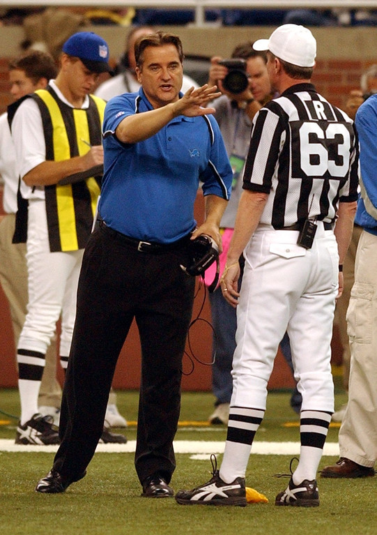 . Lions head coach Steve Mariucci discusses a call with the head referee during second half action between the Detroit Lions and the Chicago Bears at Ford Field, Sunday October 30, 2005. The Lions lost in overtime 19-13.