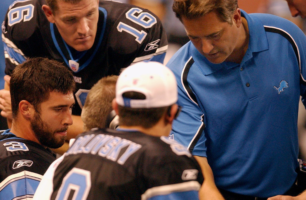 . Detroit Lions head coach Steve Mariucci,right, chaqts with QB Joey Harrington (3) (left) after he threw an interception against the St. Louis Rams during Monday night football played at Ford Field in downtown Detroit.
