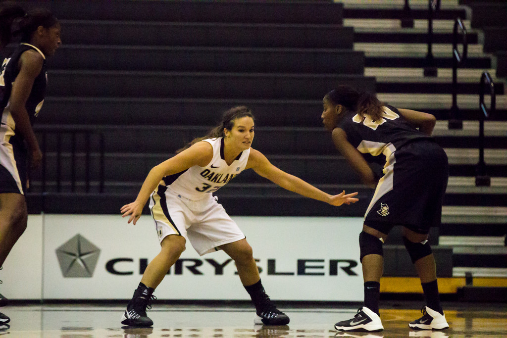 . #32 Amy Carlton guards her UCF opponent. Photo by Dylan Dulberg