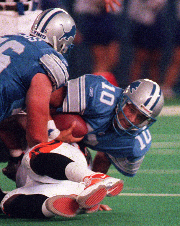 . Detroit Lions quarterback Charlie Batch is sacked by Cincinnati Bengal defender Vaugh Booker during an exhibition game against  at the Pontiac Silverdome Friday night.
