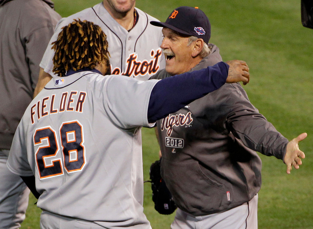 . Detroit Tigers first baseman Prince Fielder hugs manager Jim Leyland after the Tigers beat the Oakland Athletics 6-0 in Game 5 of an American League division baseball series in Oakland, Calif., Thursday, Oct. 11, 2012. (AP Photo/Eric Risberg)