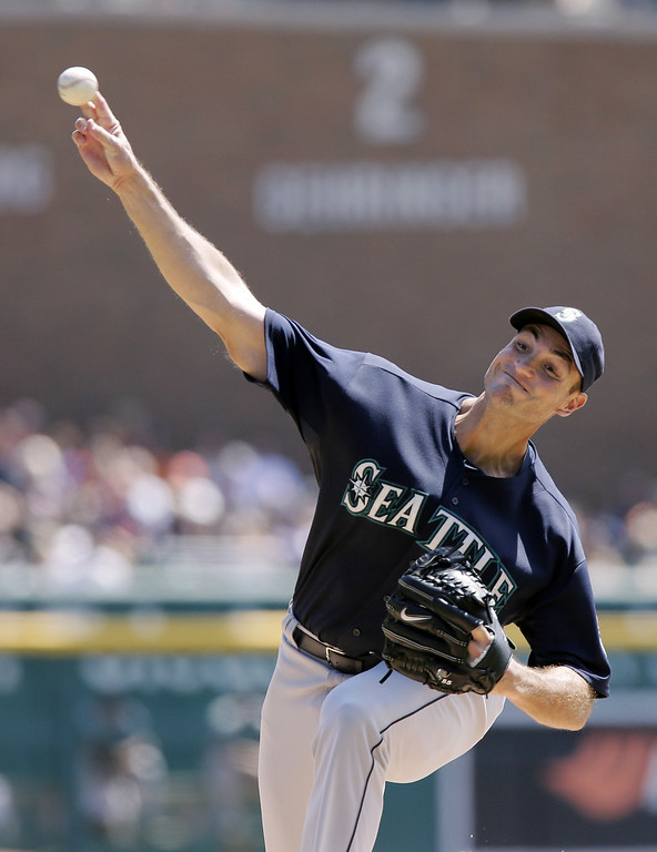 . Seattle Mariners\' Chris Young pitches against the Detroit Tigers during the first inning of a baseball game Sunday, Aug. 17, 2014, in Detroit. (AP Photo/Duane Burleson)