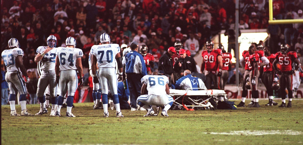 . When Detroit LIons Quarterback , Scott Mitchell,went down in the playoff game in Tampa verses the Buccaneers, everyone feared the worst, but he suffered only from a mild concussion. Every precausion was taken as he was wheeled off the field.