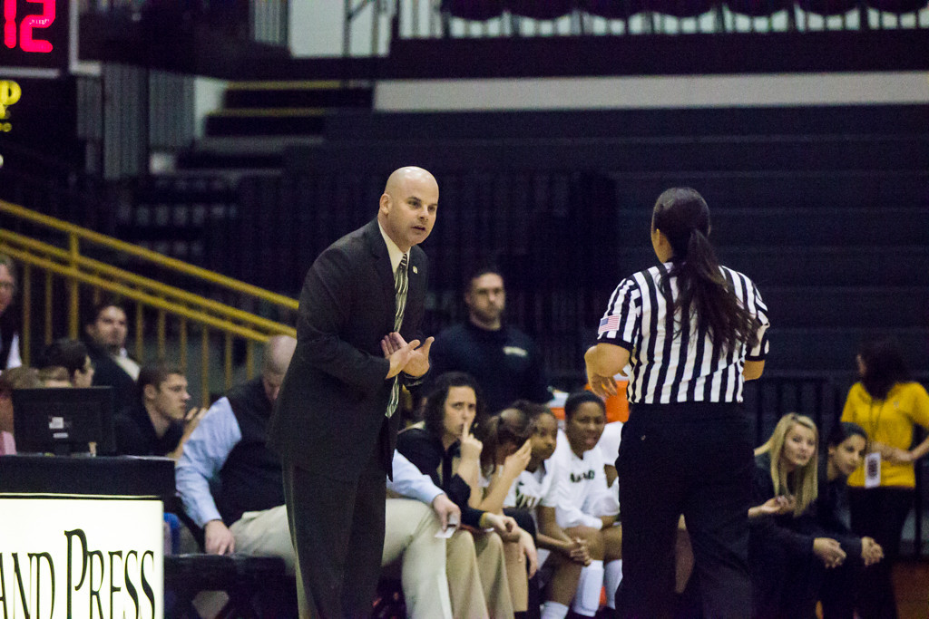 . Coach Jeff tungate discusses a call with the referee. Photo by Dylan Dulberg