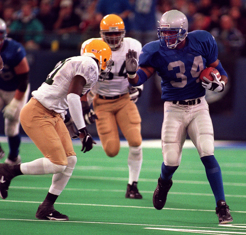 . Detroit Lions Running Back James Stewart  (right) fends off Green Bay Packer defender Bhawoh  Jue (left) as he gains yardage late in the Lions\' 29-27 loss Thanksgiving Day at the Pontiac Silverdome.