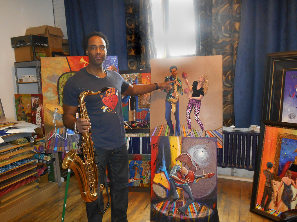 . Marcus Glenn points out the characters representing himself and his wife, Yolanda, which he picked up from his jazz design and put onto a new background to demonstrate his work technique. The picture below, of the man playing a guitar, is his first Flat Life picture, created after 9/11. The light symbolizes not only the light of God, but also the fact that America was in the spotlight after that event, Glenn said. Photo by Nicole M. Robertson