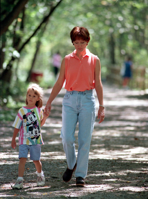 . Debbie Erwin walks with her daughter Hannah, 5,  down the Paint Creek Trail near the Yates Cider Mill in Rochester Hills.
