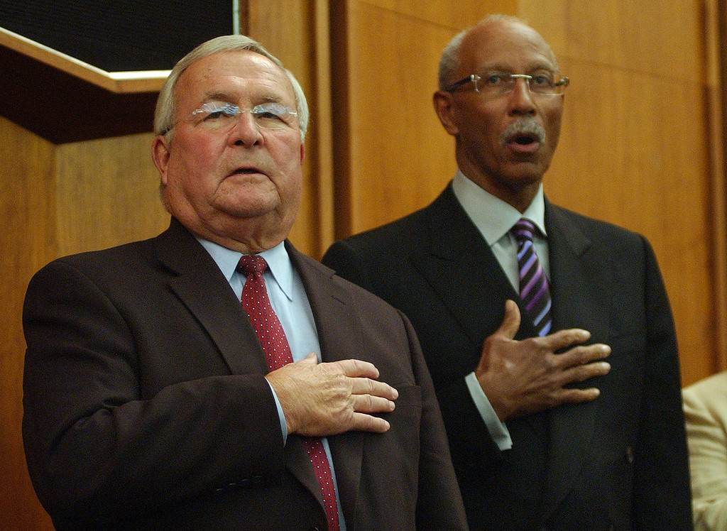 . Oakland County Executive L. Brooks Patterson, left, and City of Detroit Mayor Dave Bing, recite the national anthem, at the Board of Commissioners Auditorium, Wednesday, September 2, 2009, in Pontiac, Mich.  (The Oakland Press/Jose Juarez)