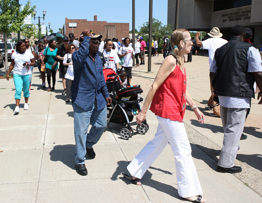 . MartinRally-1.07202013 Around 100 people turned out for the Rally for Justice for Trayvon Martin at the 50th District Court House in Pontiac Saturday, July 20, 2013. The rally and protest march were organized by the Pontiac Team for Justice. (Special to The Oakland Press / LARRY McKEE)