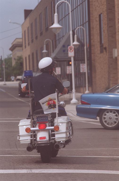 . Pontiac Police patrolman-Dan Casey rides along the streets of Pontiac (part of community policing) during Dream Cruise