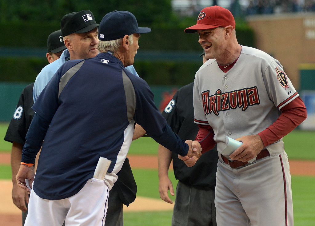 . Detroit Tigers Manager Jim Leyland, left, greets Arizona Diamondbacks Manager Kirk Gibson during the exchange of lineups before the start of their game.  Photo taken on Friday, June 24, 2011, at Comerica Park in Detroit, Mich.  (The Oakland Press/Jose Juarez)