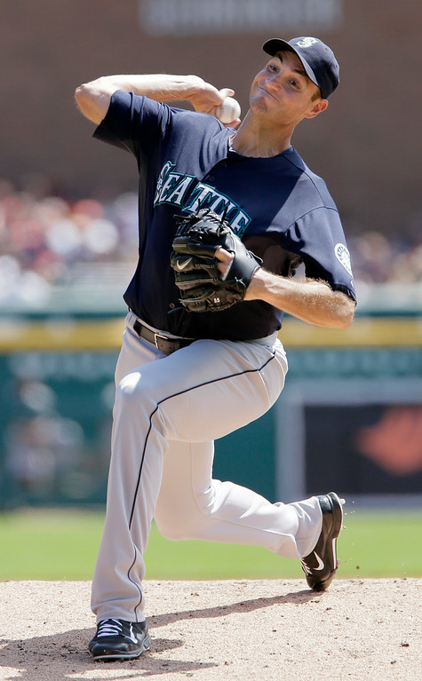 . Seattle Mariners\' Chris Young pitches against the Detroit Tigers during the first inning of a baseball game on Sunday, Aug. 17, 2014, in Detroit. (AP Photo/Duane Burleson)