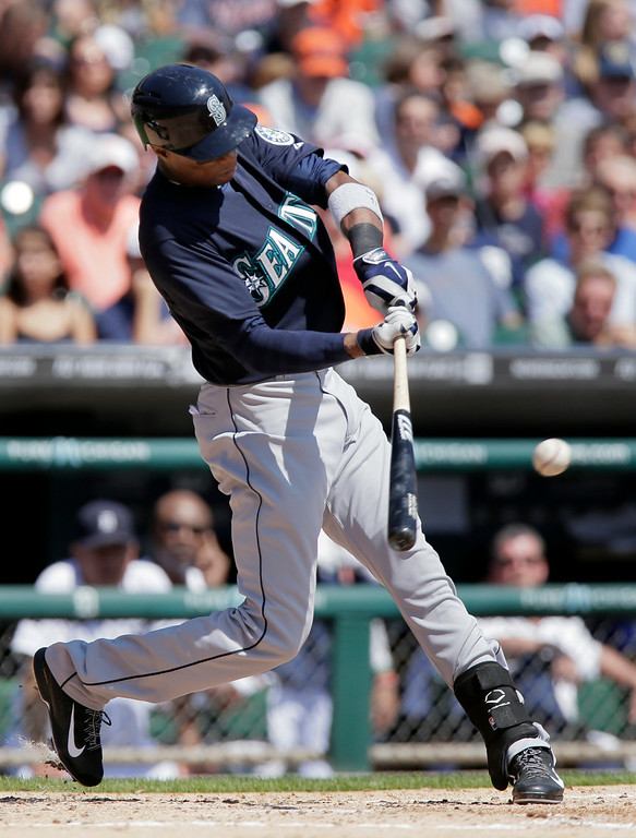 . Seattle Mariners\' Austin Jackson singles against the Detroit Tigers during the second inning of a baseball game on Sunday, Aug. 17, 2014, in Detroit. (AP Photo/Duane Burleson)