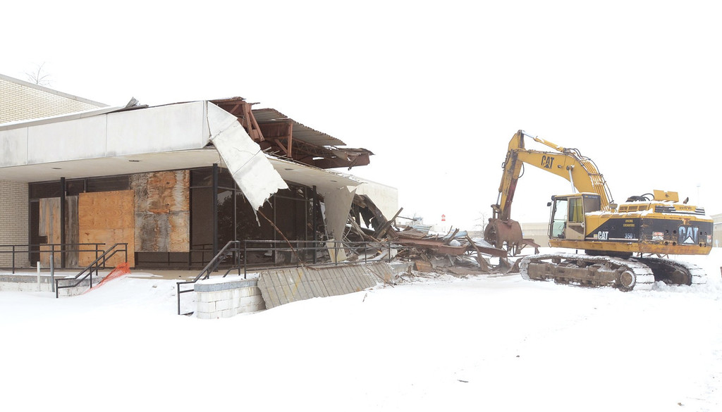 . Demolition crews start tearing down the Cinema III at the Summit Place Mall in Waterford Township. The contractor said it should take about three weeks.    Tuesday, February 4, 2014.  Tim Thompson-The Oakland Press