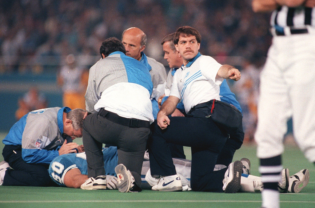 . Detroit Lions medical personal attend Detroit Lions Mike Utly on the field after being seriously injured during a game against the Los Angeles Rams on Nov 17, 1991.  Utly\'s injury paralized him from the waist down ending his professional football career.