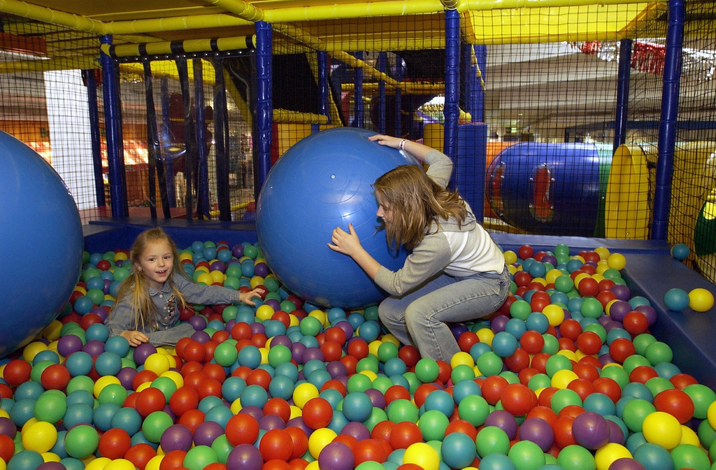 . Once inside the large play area, there are many tubes to crawl through, rope and tube bridges to cross, levels to explore, and a couple of areas like this filled with soft plastic balls to play in. Here sisters Paige (left) and Shelby McClelland of Waterford sink down into the balls as they play.