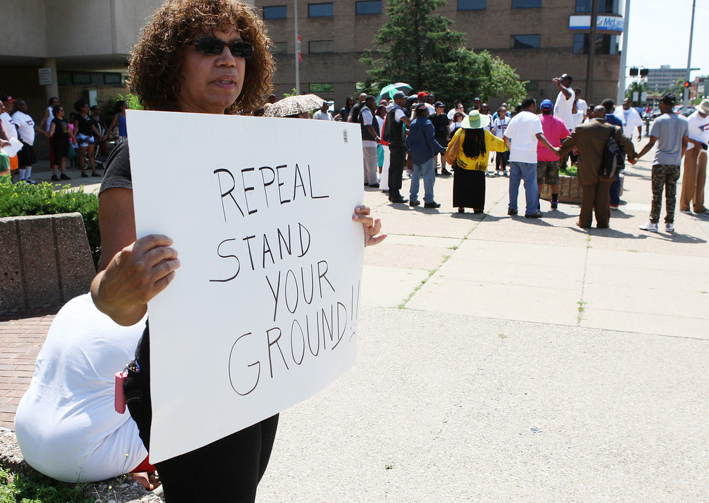 . MartinRally-2.07202013 Judy Wiles, Rochester, was one of nearly 100 people that attended the Rally for Justice for Trayvon Martin in front of the 50th District Court House in Pontiac Saturday, July 20, 2013. The rally and protest march were organized by the Pontiac Team for Justice. (Special to The Oakland Press / LARRY McKEE)