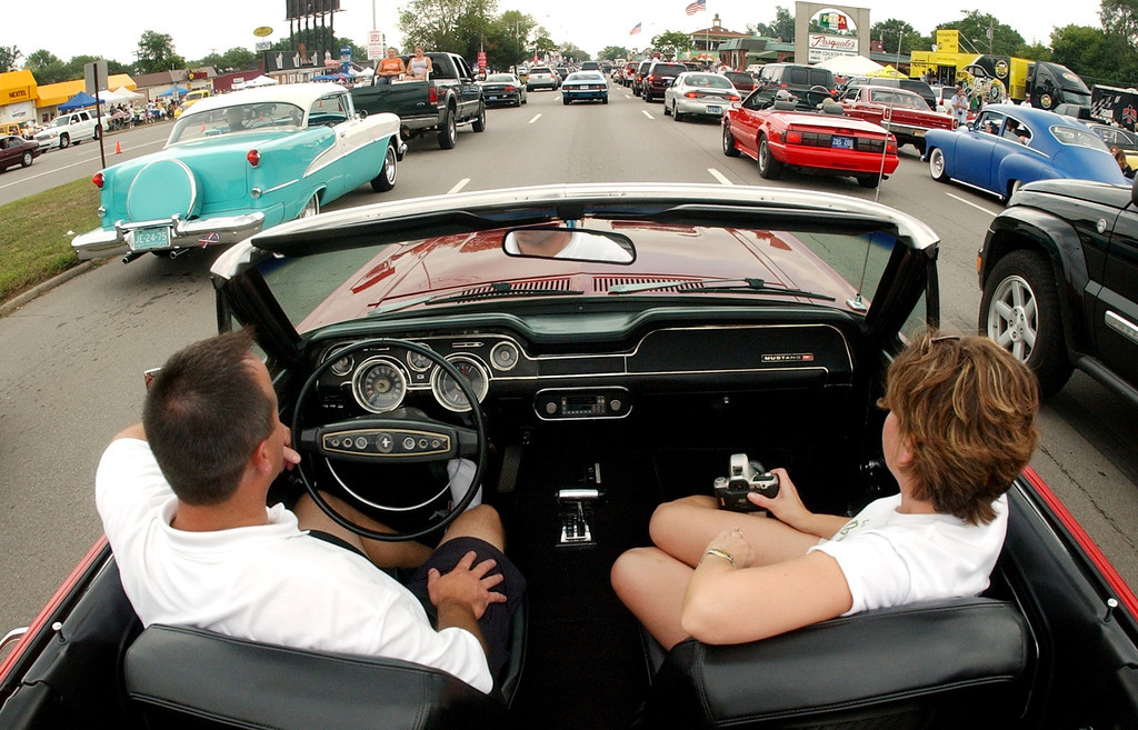 . Scott and Leslie Guyor of Ann Arbor, Mich., cruise southbound Woodward Avenue during the Dream Cruise.  Scott is driving his 1968 Mustang convertible, which was the very first car he ever bought.  Photo taken on Saturay, August 20, 2005, in Royal Oak, Mich.