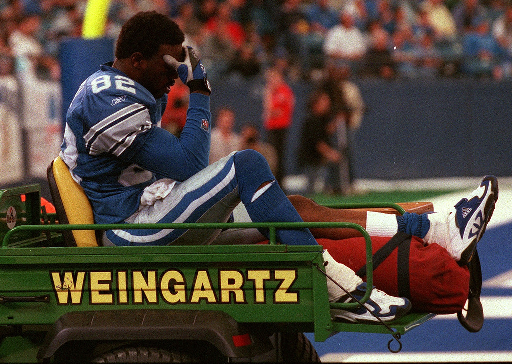 . Detroit Lions wide receiver Germane Crowell holds his head as he is taken off the field in a cart after injuring his left knee tendon during Sunday\'s 27-24 loss to the Tennessee Titans at the Silverdome. It is likely he will be out for the season.