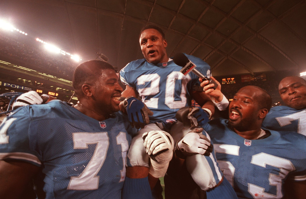 . Barry Sanders is carried off the field after finishing the season with 2053 yards.