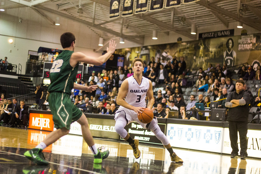 . Oakland guard Travis Bader cuts to the basket Tuesday, Oct. 29, 2013 at the Athletics Center O\'rena.  Photo by Dylan Dulberg