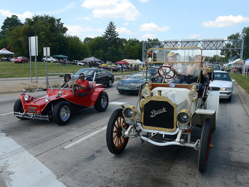 . This 1908 Buick heads south on Woodward Avenue in Pontiac during the 2013 Woodward Dream Cruise, Saturday August 17, 2013. (Oakland Press Photo:Vaughn Gurganian)