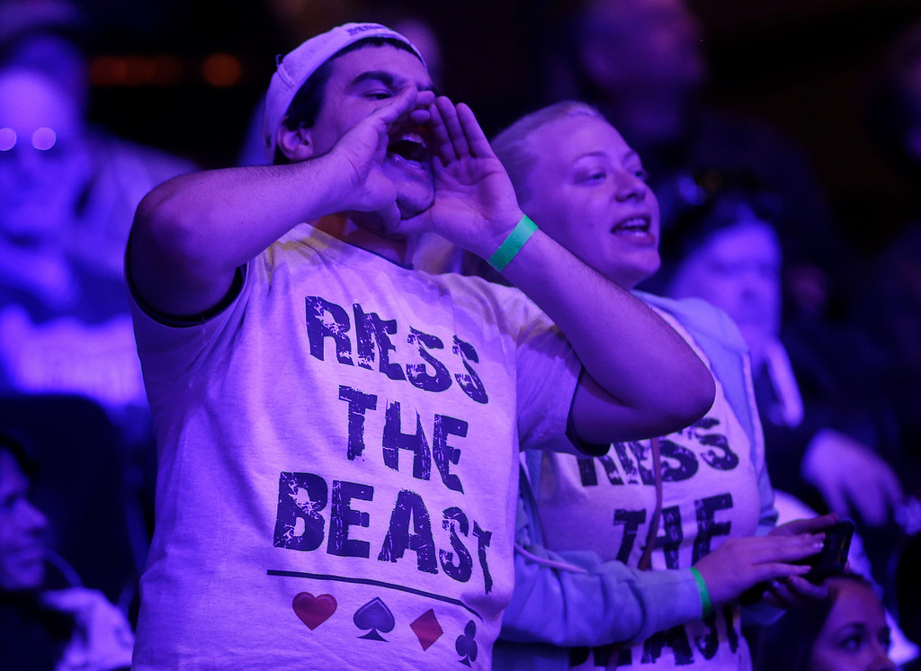 . A supporter of Ryan Riess shouts cheers of support during the World Series of Poker Final Table, Tuesday, Nov. 5, 2013, in Las Vegas. Riess defeated runner up Jay Farber for the $8.4 million payout. (AP Photo/Julie Jacobson)