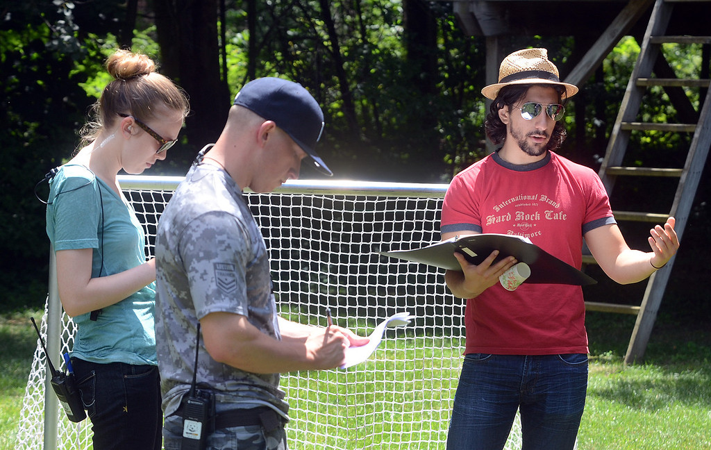""". Director Michael Angelo Zervos, of Novi, (right) goes over a scene for the movie \""""Papou,\"""" being filmed on location at a home in Novi, Thursday July 25, 2013. (Oakland Press Photo:Vaughn Gurganian)"""