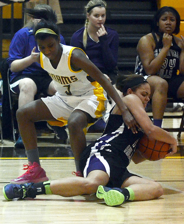 . Rochester Adams #5 Ryian Owusu and Bloomfield Hills #11 Shannon Wilson battle for a loose ball during their game at Rochester Adams High School, Thursday January 30, 2014.  Adams went on to win the game 56-50. (Vaughn Gurganian-The Oakland Press)