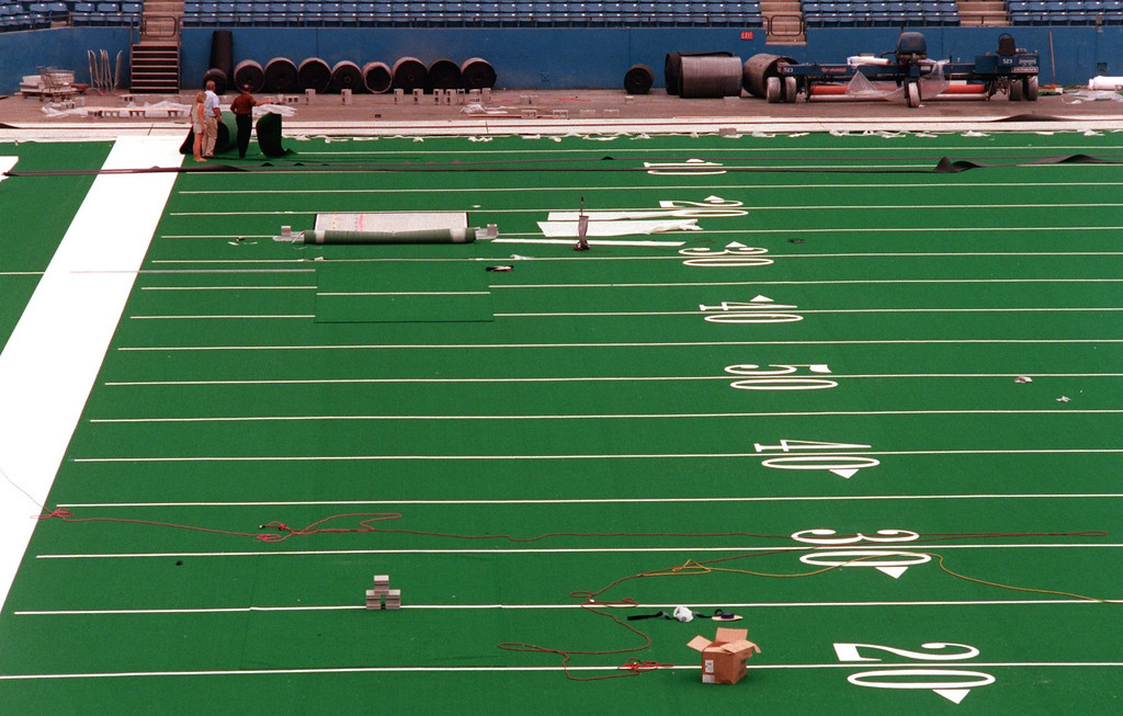 . New artificial turf being installed at the Silverdome.