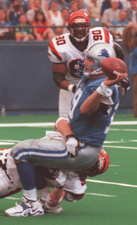 . Detroit Lions quarterback Scott Mitchell (19) gets sacked by a Cincinatti Bengals during last week game at the Pontiac Silverdome.