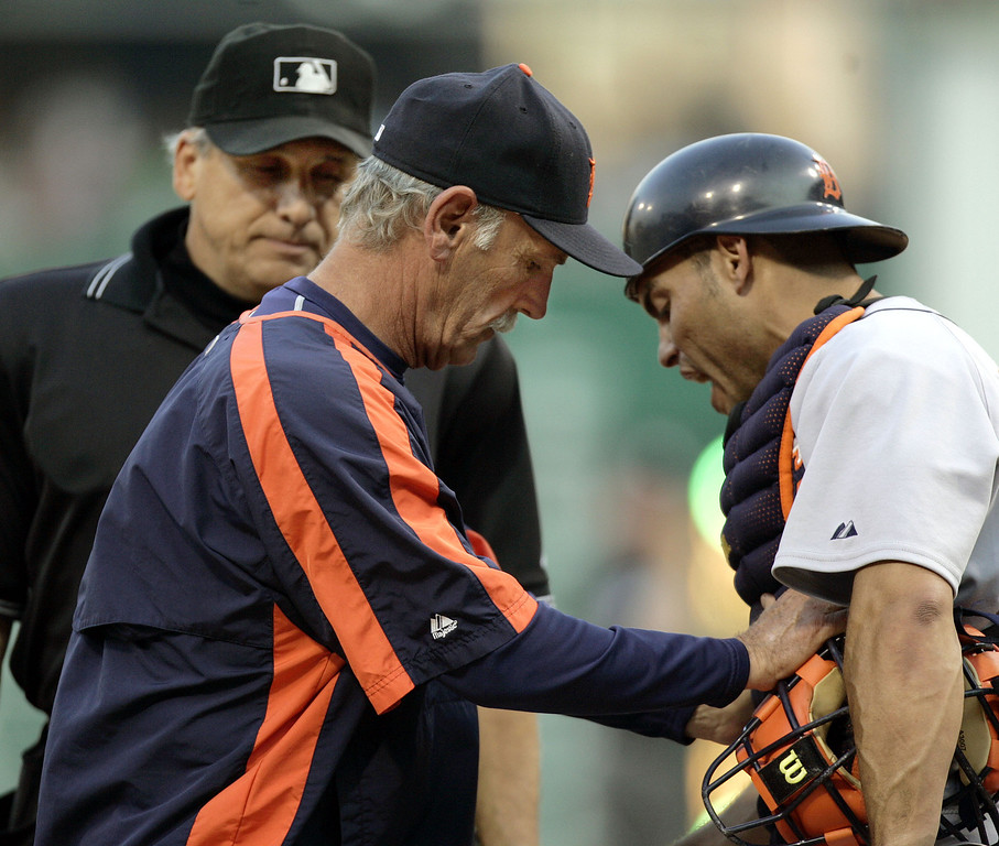 . Detroit Tigers catcher Ivan Rodriguez, right, is pushed away from homeplate umpire Larry Vanover, left, by Tigers manager Jim Leyland as he argues a safe call against the Pittsburgh Pirates in the third inning of the baseball game, Saturday, July 1, 2006, in Pittsburgh. (AP Photo/Keith Srakocic)