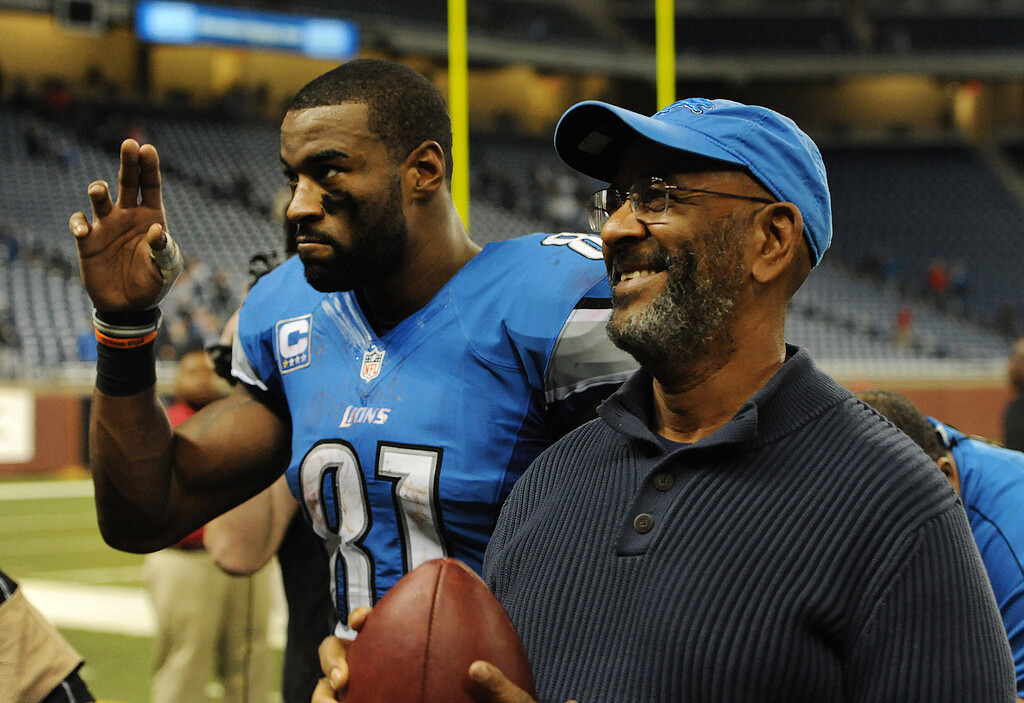 . Detroit Lions wide receiver Calvin Johnson (81) walks off the field with his father, Calvin Johnson Sr. after his team lost to the Atlanta Falcons, 31-18.  Photo taken on Saturday, December 22, 2012, at Ford Field in Detroit, Mich.  (Special to The Oakland Press/Jose Juarez)