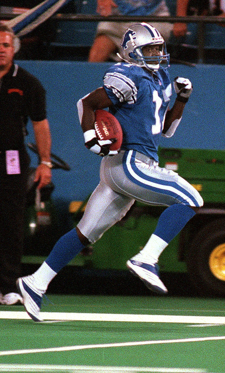 . Detroit Lions Wide Receiver Larry Foster races up the visiting sideline for a touchdown during an exhibition game against the Cincinnati Bengals at the Pontiac Silverdome Friday night.