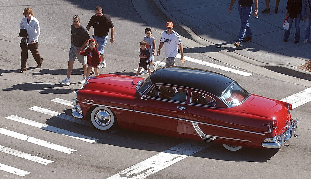 . Pedestrians check out a classic car along Woodward Ave. in Birmingham during the 2004 Woodward Dream Cruise, Saturday August 21, 2004.