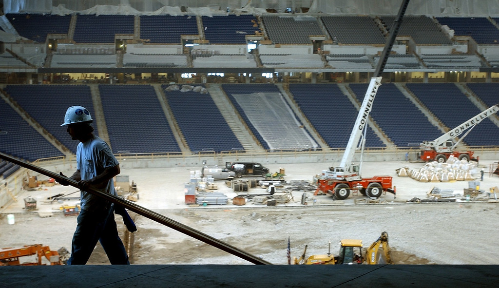 . A construction worker lays metal bars down near the seating area inside the new Ford Field, future site of the NFL Detroit Lions in downtown Detroit.