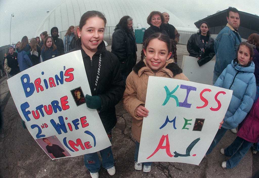 . Among the hundreds of fans lining the Silverdome for Thursday\'s Backstreet Boys Show were Julie Barbaro,11, (left) and her sister Nicole,9, with their homemade signs.