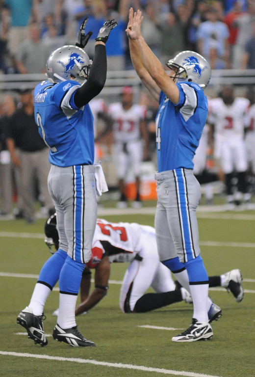 . Detroit Lions kicker Jason Hanson, right, celebrates with teammate Nick Harris after Hanson kicked the game winning field goal to beat the Atlanta Falcons on the last play of the game, Saturday, August 15, 2009, in Detroit, Mich.  The Lions beat the Falcons, 27-26.  (The Oakland Press/Jose Juarez)