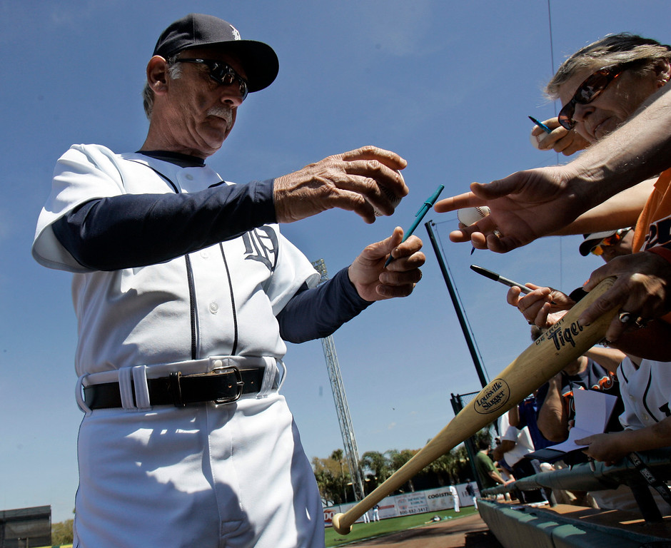. Detroit Tigers manager Jim Leyland hands back a ball after signing an autograph before the Tigers play the New York Mets during spring training baseball Saturday, Feb. 28, 2009, in Lakeland, Fla. The Tigers won 7-2. (AP Photo/Tony Dejak)