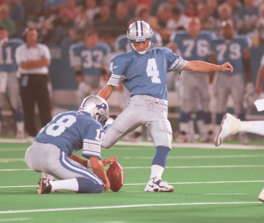 . Detroit Lions kicker Jason Hanson (right, #4) prepares to kick a field goal attempt as teammate John Jett (#18) holds the ball, during second quarter action at the Pontiac Silverdome, Friday, August 14, 1998.  Hanson missed this attempt.