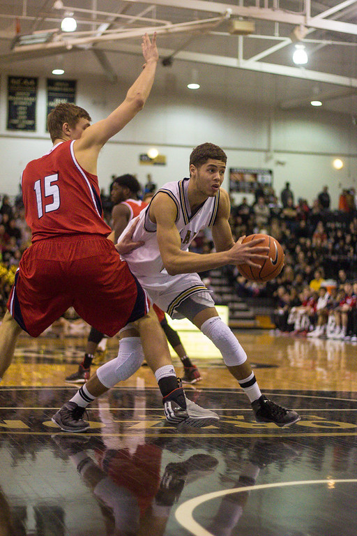 . Dante Williams attempts to get the ball past the UIC defender. Photos by Dylan Dulberg/The Oakland Press