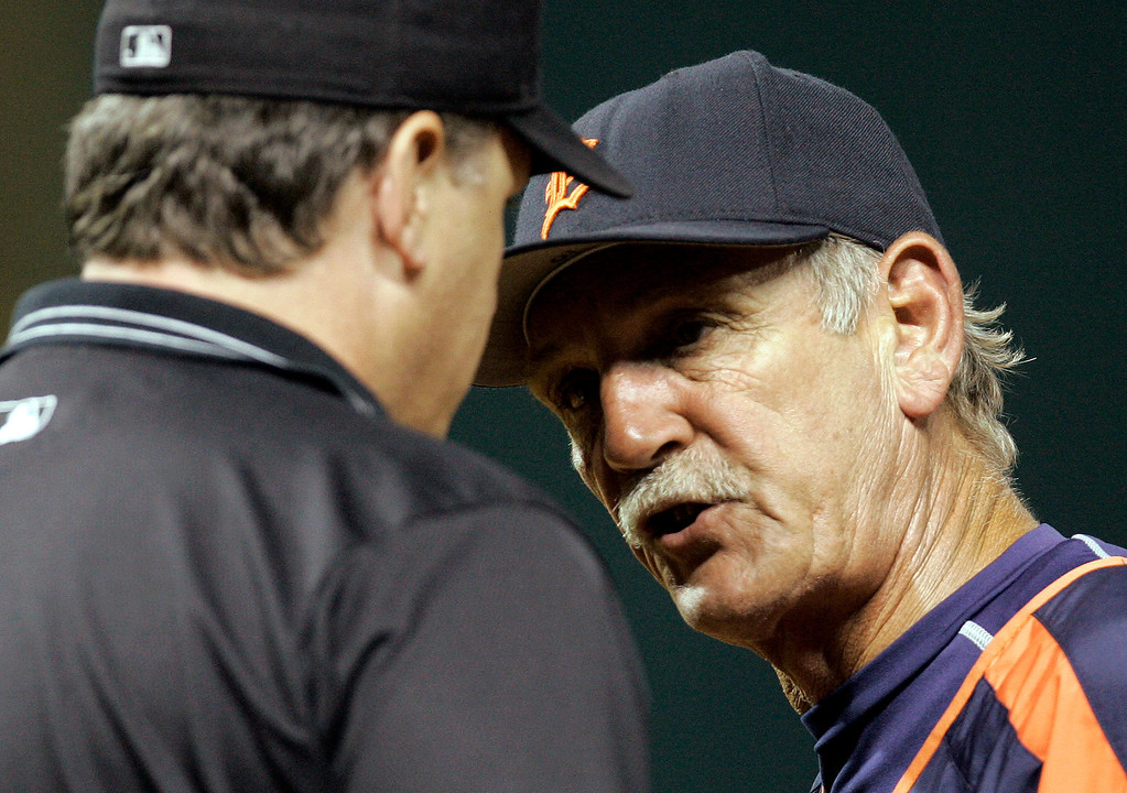 . Detroit Tigers\' manager Jim Leyland, right, argues with first base umpire Paul Emmel on whether Cleveland Indians\' Kelly Shoppach was out at first base in the eighth inning, in baseball action, Monday, July 24, 2006, in Cleveland. (AP Photo/Tony Dejak)