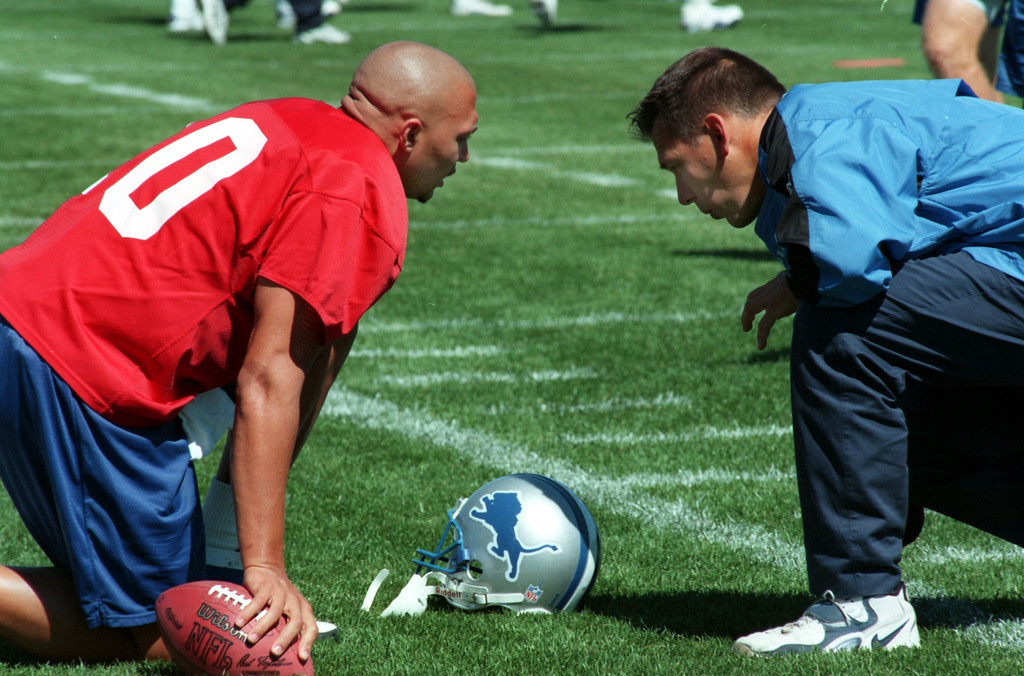 . Detroit Lions quarterback Charlie Batch chats with quarterback coach Jim Zorn.